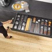 Image from: Blum New Zealand floor, flooring, furniture, product, product design, shelf, shelving, table, wood, orange, black