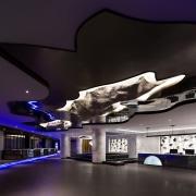 Rock hangs down through the ceiling architecture, automotive design, ceiling, interior design, product design, black