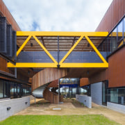 A striking access way connects two parts of architecture, building, commercial building, daylighting, facade, leisure centre, real estate, residential area, roof, structure, black