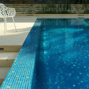 A classic blue tile mosaic gives this pool aqua, leisure, property, swimming pool, water, water feature, blue