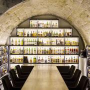This new whiskey bar takes advantage of a interior design, black