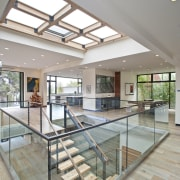 Another view of the skylight apartment, ceiling, condominium, daylighting, estate, floor, flooring, glass, handrail, house, interior design, property, real estate, window, gray