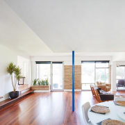 The living area is slightly lower than the apartment, ceiling, daylighting, estate, floor, house, interior design, living room, property, real estate, window, white