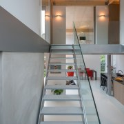 The staircase is minimal – meaning it doesn't architecture, house, interior design, loft, stairs, gray