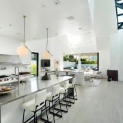 This large stainless steel island has ample room countertop, interior design, kitchen, real estate, white
