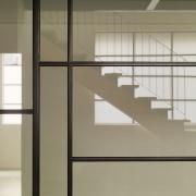 A translucent screen creates a painting-like effect architecture, daylighting, door, floor, glass, handrail, home, interior design, line, shelf, shelving, wall, window, orange, gray