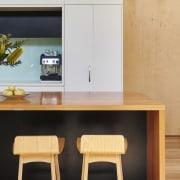 Altereco Design utilised wood throughout the renovation – chair, furniture, interior design, product design, table, orange, black