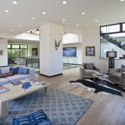 The living areas radiate out from a large, ceiling, daylighting, floor, home, interior design, living room, real estate, wall, gray
