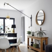 Interior decorating choices on display in the dining furniture, home, interior design, lamp, light fixture, lighting, living room, product design, table, white, gray