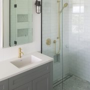 A marble border in the shower floor is bathroom, bathroom accessory, bathroom cabinet, plumbing fixture, room, tap, tile, gray