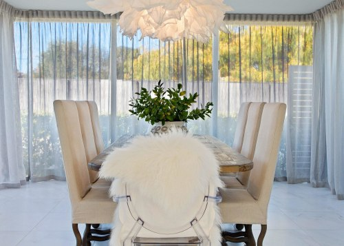 This formal dining room steps down from the building, ceiling, chair, chandelier, curtain, dining room, floor, furniture, home, house, interior design, light fixture, lighting, living room, product, property, real estate, room, table, textile, white, window treatment, yellow, gray