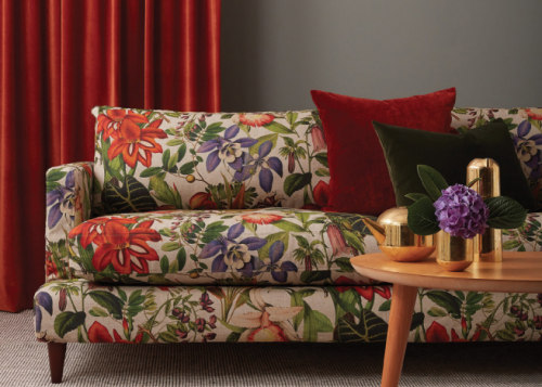 Instead of placing a couple of sofas in chair, couch, cushion, floor, furniture, interior design, living room, loveseat, pillow, room, slipcover, sofa bed, studio couch, table, textile, throw pillow, red, gray