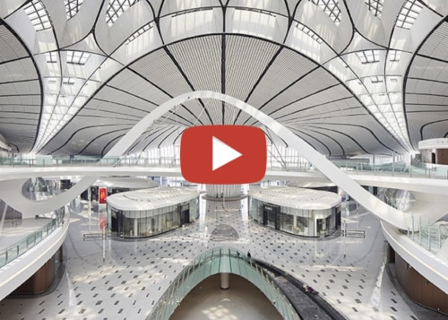 Beijingdaxingintairport video button - arch | architecture | arch, architecture, building, ceiling, daylighting, escalator, skyway, gray