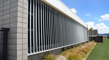 78580_louvretec-new-zealand-ltd_1556755727 - architecture | building | facade | architecture, building, facade, grass, home, house, metal, property, real estate, siding, wall, black