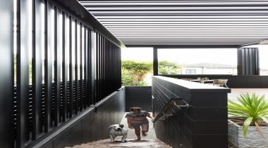 78580_louvretec-new-zealand-ltd_1556757041 - architecture | balcony | building | architecture, balcony, building, courtyard, daylighting, facade, home, house, interior design, room, black, white