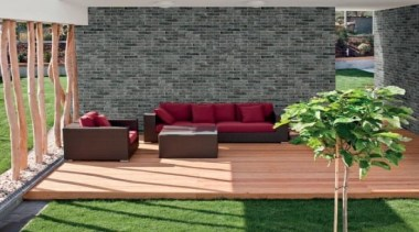 Brick One will never require sealing and is backyard, couch, floor, flooring, furniture, grass, hardwood, outdoor furniture, outdoor structure, patio, table, wall, wood, gray
