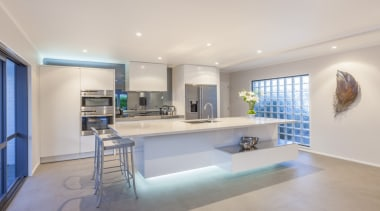 White contempary kitchen floating island with LED lighting architecture, ceiling, countertop, interior design, kitchen, real estate, gray