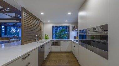 Wood floors and metal appliances both work well architecture, building, cabinetry, ceiling, countertop, design, floor, flooring, furniture, glass, home, house, interior design, kitchen, light fixture, lighting, material property, property, real estate, room, gray