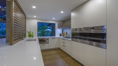 This workspace provides the private prep and cooking architecture, building, cabinetry, ceiling, countertop, design, estate, floor, flooring, furniture, glass, hardwood, home, house, interior design, kitchen, lighting, property, real estate, room, wood flooring, gray