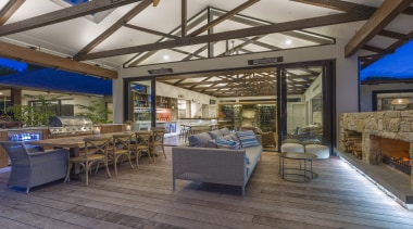 This spacious indoor-outdoor home has the air of architecture, building, ceiling, estate, floor, flooring, furniture, home, house, interior design, property, real estate, roof, room, gray