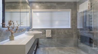 Introducing a large heated towel rack to this architecture, bathroom, building, ceramic, floor, flooring, glass, interior design, marble, material property, plumbing fixture, property, real estate, room, tile, window covering, gray