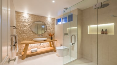 ​​​​​​​Read the full story. bathroom, home, interior design, real estate, room, brown, gray