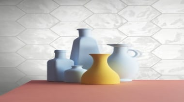 HEXA WALL has an undulating surface that ensures ceramic, drinkware, floor, flooring, glass bottle, product, still life photography, table, vase, wall, white
