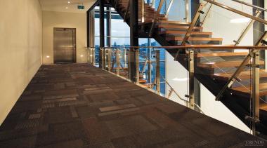 Above Left Commercial-grade Feltex tiled carpet in Moonstruck floor, flooring, handrail, hardwood, stairs, wood, wood flooring, black