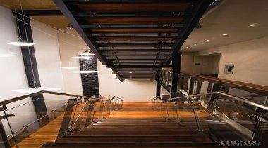 Above A steel-and-timber staircase is cantilevered through the apartment, architecture, ceiling, daylighting, handrail, house, interior design, lobby, loft, property, real estate, stairs, wood, brown, black