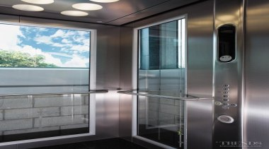 Below far left Kone Elevators supplied and installed gray, black