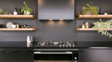 Bold kitchen features Fisher & Paykel appliances - cabinetry, countertop, floor, flooring, furniture, interior design, kitchen, kitchen stove, living room, material property, room, shelf, stove, table, tile, wall, gray, black