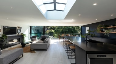 Bold kitchen features Fisher & Paykel appliances - apartment, architecture, building, cabinetry, ceiling, countertop, design, estate, floor, flooring, furniture, home, house, interior design, kitchen, lighting, living room, property, real estate, room, table, gray, black