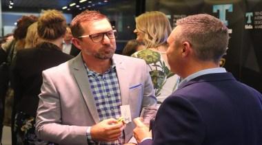 TIDA Kitchens 2019 - conversation | employment | conversation, employment, event, fun, interaction, suit, white-collar worker, yellow, black