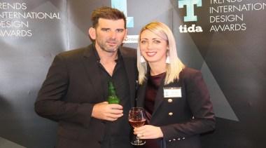 Hayden Ball and Kirsty Davis - conversation | conversation, distilled beverage, event, liqueur, suit, white-collar worker, black, gray