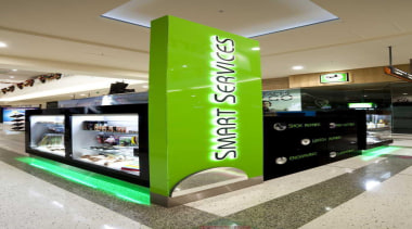 Appealing green kiosk in the middle of a retail, technology, gray