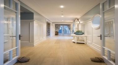 Hallway - ceiling   daylighting   estate   ceiling, daylighting, estate, floor, flooring, hall, hardwood, home, interior design, laminate flooring, lobby, molding, real estate, room, tile, wall, window, wood flooring, gray