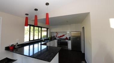 Kitchen design features red hot chilli splash back. house, interior design, property, real estate, gray