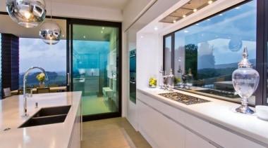 A contemporary house design by Design House Architecture bathroom, estate, home, interior design, property, real estate, room, window, gray