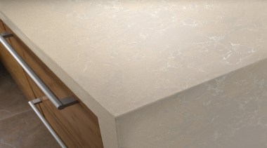 Daria depicts a subtle and harmonious mixture of countertop, floor, plaster, wall, wood stain, gray