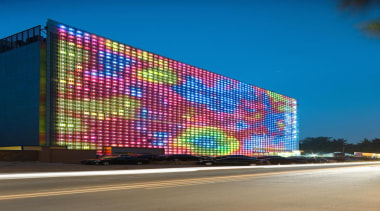 Designed by SGP Architects the GreenPix Zero Energy architecture, building, commercial building, corporate headquarters, display device, electronic signage, facade, headquarters, landmark, led display, light, metropolis, metropolitan area, sky, structure, teal