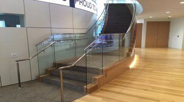 Curved tempered glass designed with precision measurements makes floor, flooring, glass, handrail, stairs, gray