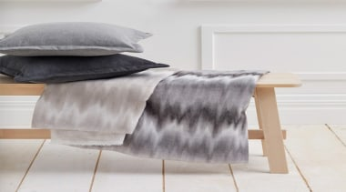 Serene and timeless, COAST combines a stylish ombre bed frame, bed sheet, cushion, duvet cover, floor, furniture, linens, product, textile, white, gray