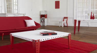 Meccano Home is a new collection from the chair, coffee table, floor, flooring, furniture, interior design, living room, product design, table, wood, red, gray