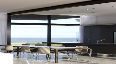High performance windows frame stunning sea views. The architecture, daylighting, interior design, shade, table, window, window covering, gray, black