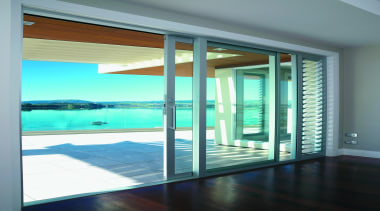 Beautiful blue seas easily seen through Euroslider doors. architecture, condominium, daylighting, door, glass, house, interior design, property, real estate, window, window covering, teal, gray