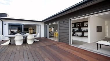 Simple lines and a blend of popular modern deck, floor, flooring, hardwood, house, interior design, property, real estate, window, wood flooring, gray