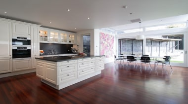 Contemporary technology is combined with timeless aesthetics and cabinetry, countertop, cuisine classique, floor, flooring, hardwood, interior design, kitchen, laminate flooring, property, real estate, room, wood flooring, gray