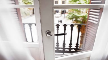 1934, Solid Lever Handle attached to  rose.Bright door, furniture, handrail, home, iron, product, window, white