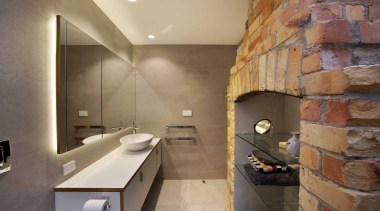 The double sided fireplace links bedroom and ensuite. bathroom, floor, interior design, room, tile, brown, orange