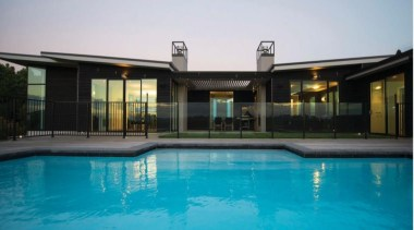 A design by Design House Architecture that focuses estate, facade, home, house, leisure, property, real estate, resort, swimming pool, villa, window, teal, black
